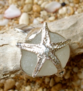 White Beach Glass Bezeled in Sterling Silver caged by a Sterling Silver Star Fish