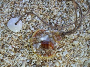 Hawaiian Sunrise sand resin filled back, puka shell clasp necklace, hemp