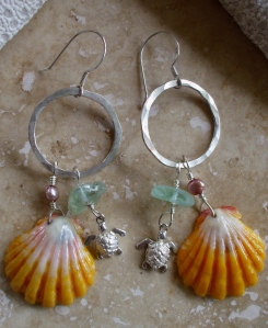 Hawaiian Sunrise shell earrings with beach glass, fresh water pearls, and sterling charms hanging from medium sized hammered hoops, sterling silver